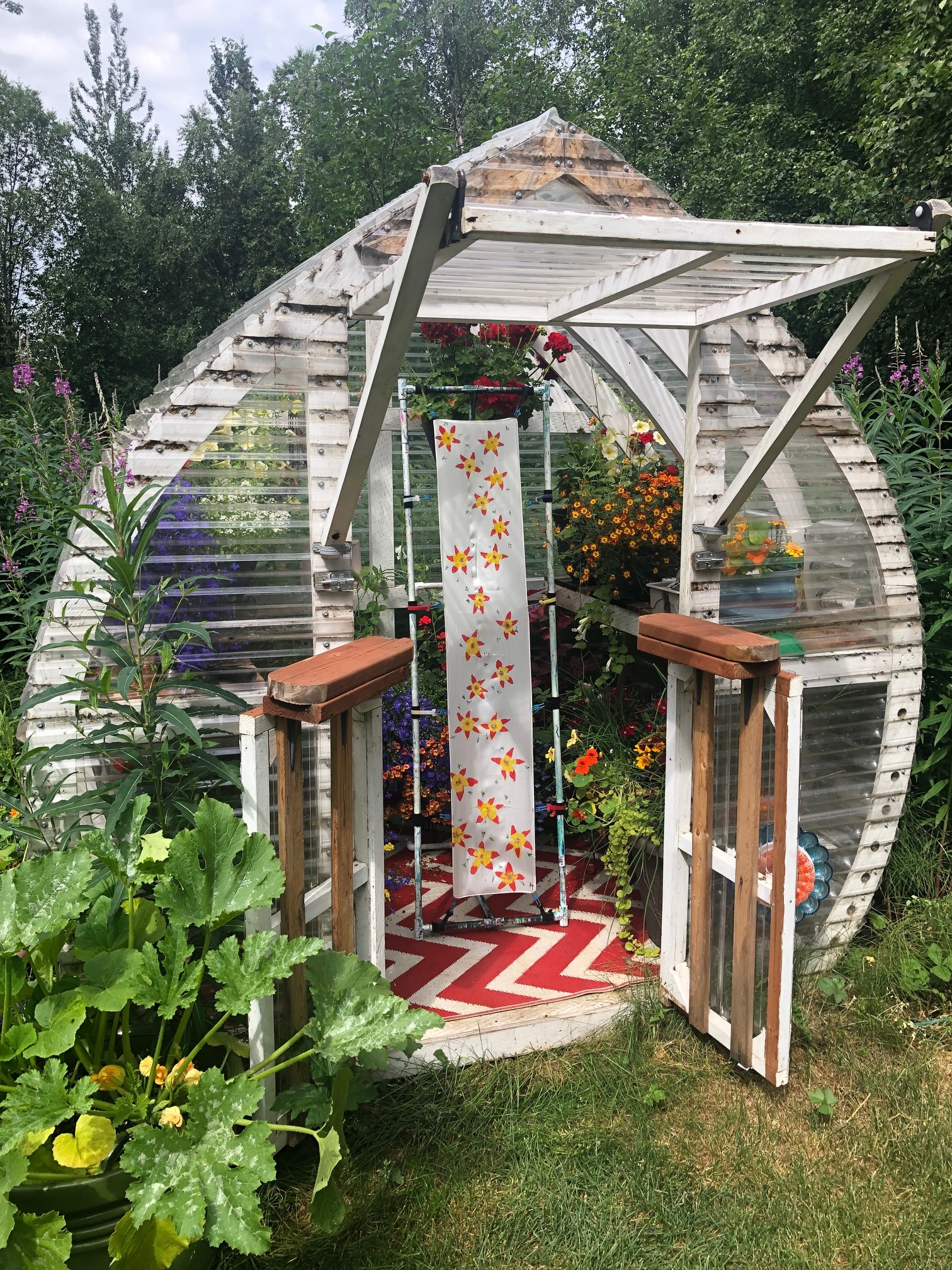 A hand-painted silk scarf in tiny greenhouse with the flowers that inspired the painting